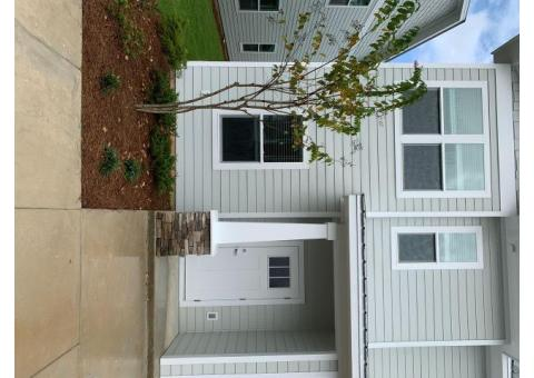 BRAND NEW, 3 bedroom, 2.5 bath end unit townhome with upgrades and a community pool!