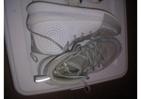 2 pairs size 9 woman's Under Armour basketball shoes